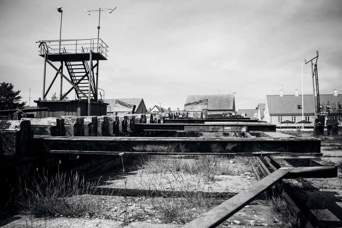 Black And White Blackandwhite Built Structure Deterioration Development No People Rusty Ship Yard Sky