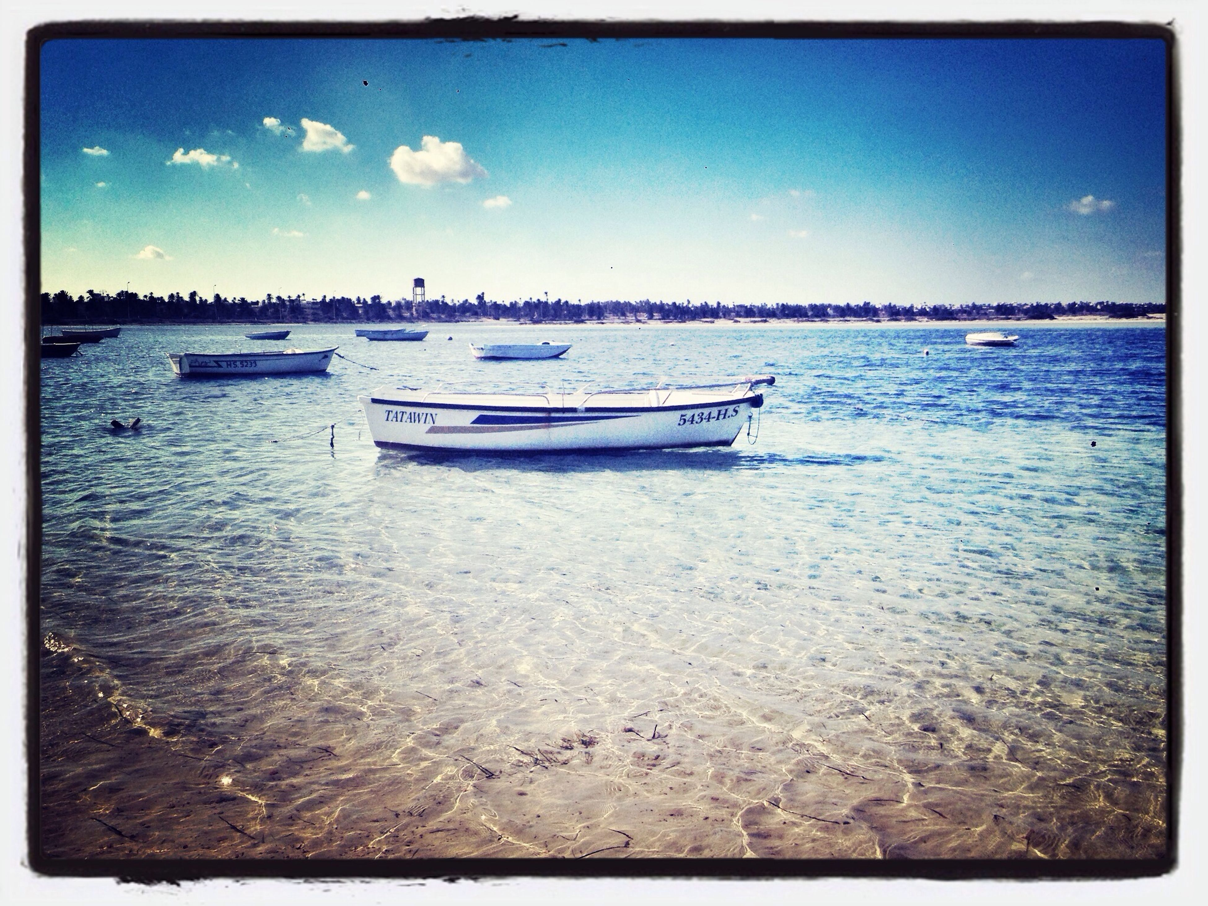 transfer print, water, nautical vessel, transportation, boat, sea, auto post production filter, mode of transport, moored, sky, blue, tranquil scene, tranquility, scenics, beauty in nature, nature, waterfront, rippled, horizon over water, outdoors