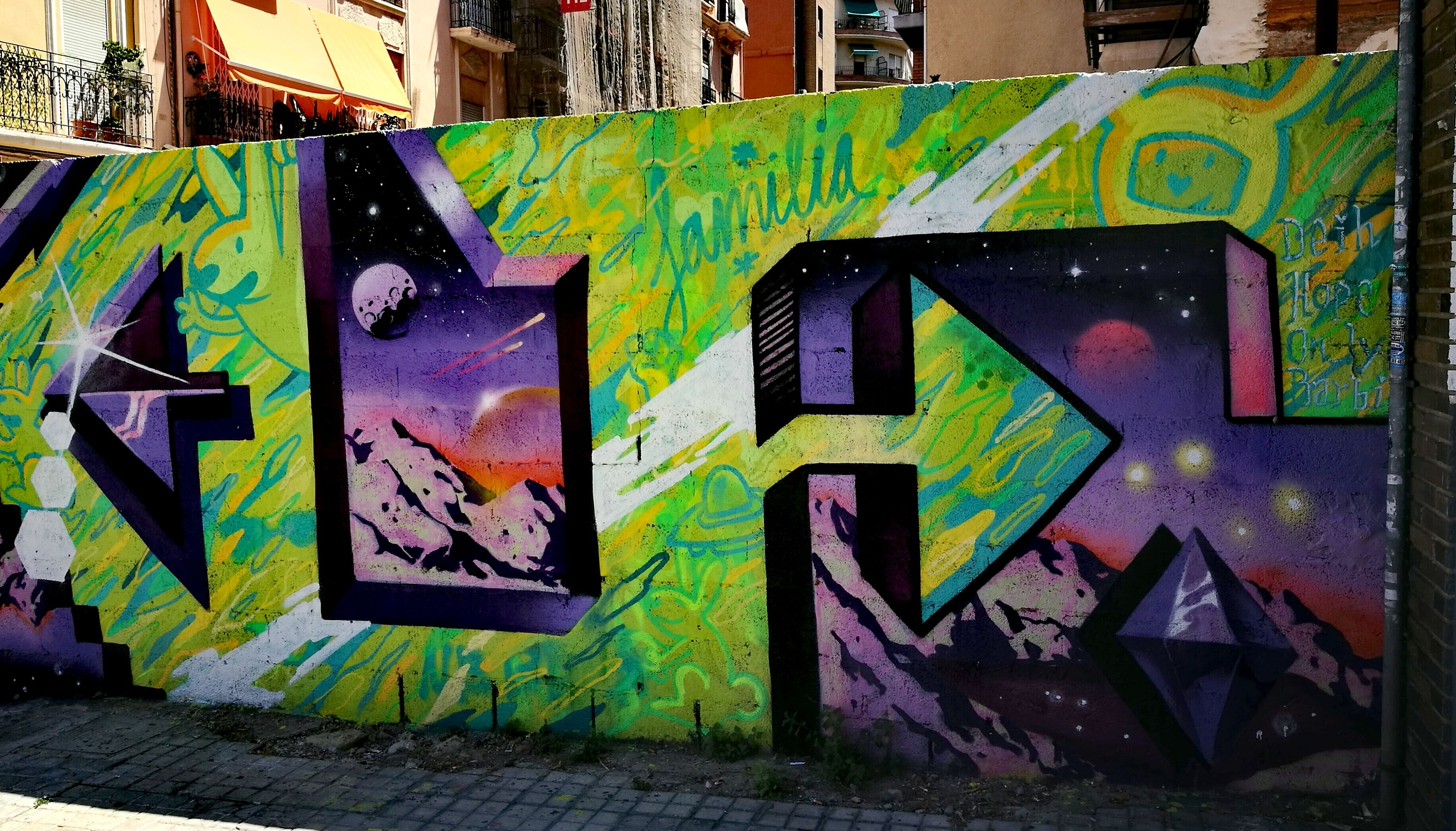 graffiti, architecture, art and craft, built structure, street art, multi colored, communication, city, outdoors, building exterior, day, no people, ghetto, close-up