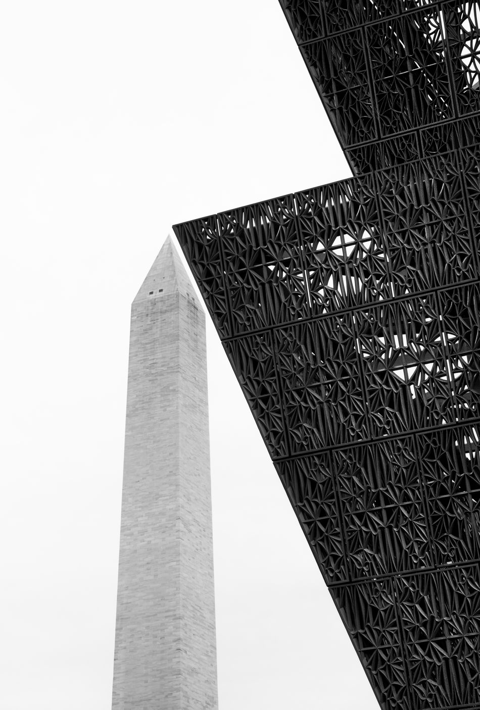 Washington Monument and the National Museum of African American History and Culture African American African American Museum Architecture B&w B&w Photography Black & White Black And White Building Exterior Built Structure City Day Low Angle View Metalwork Monument Museum National Museum Of African American History And Culture No People Outdoors Sky Skyscraper Smithsonian Washington Monument