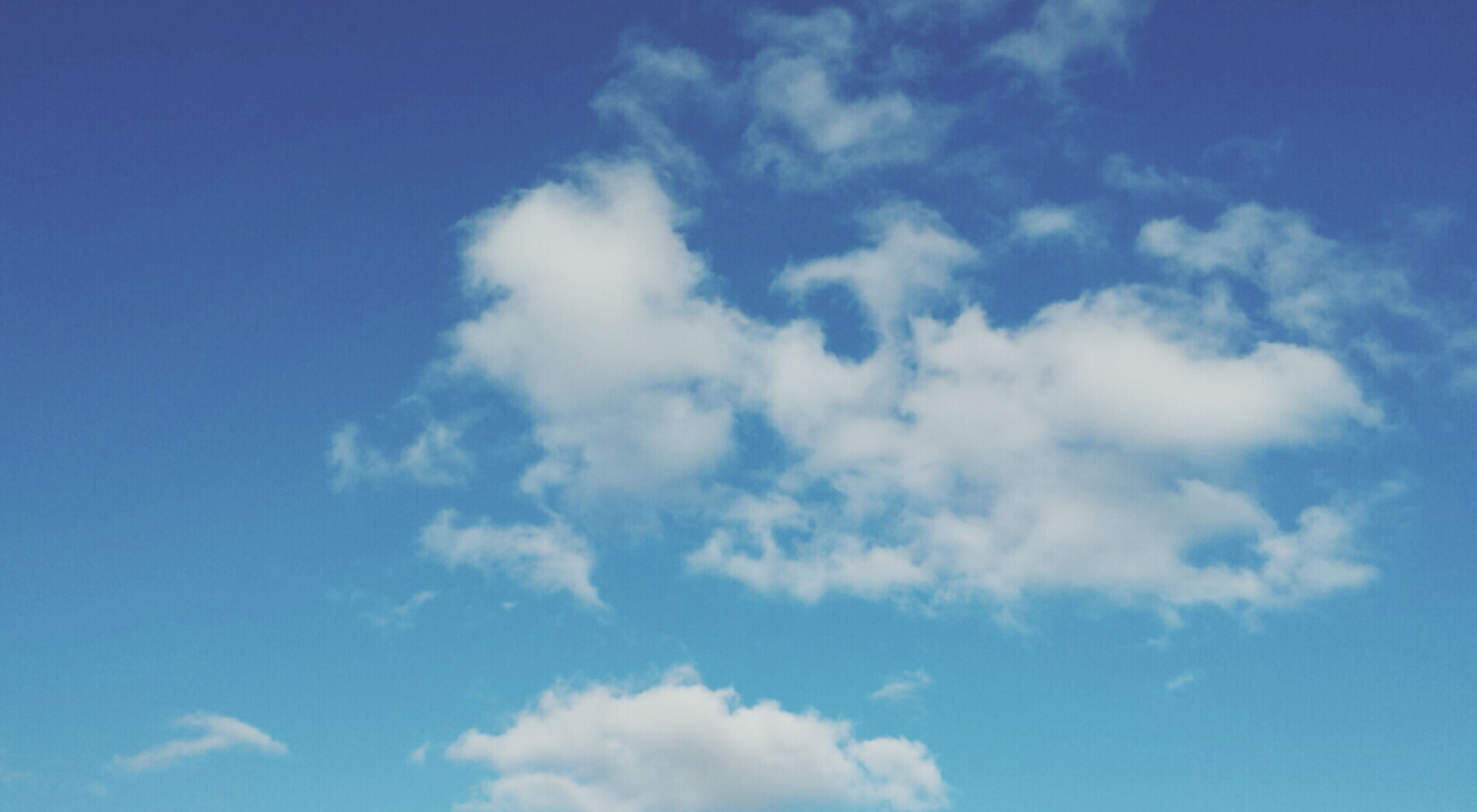 blue, low angle view, sky, beauty in nature, cloud - sky, tranquility, nature, sky only, scenics, tranquil scene, cloud, white color, backgrounds, day, outdoors, idyllic, no people, cloudscape, cloudy, full frame