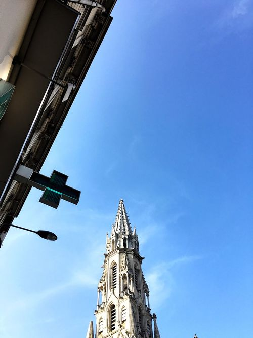 À chacun sa croix Lille France Church Cross Notredamedepentecote Notredame Pharmacy Drugstore Pharmacie Sky Bluesky Sun Architecture French Frenchbuildings Frenchlife