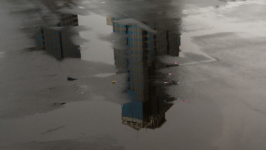 Reflection of Central Bank of Indonesia After The Rain Architecture Building Exterior Central Bank Central Bank Of Indonesia Day High Rise Building Metropolis No People Outdoors Puddle Reflection Skyscraper Water Shades Of Winter The Graphic City