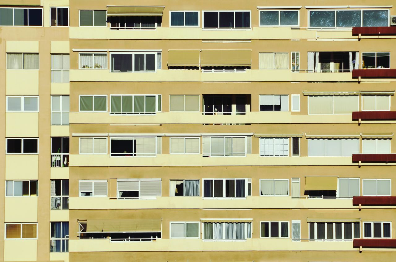 Building Exterior Architecture Window Built Structure Residential Building City No People Balcony Yellow Outdoors Day Bonjour Tristesse Urban Geometry EyeEm Masterclass Eye4photography  Shootermag NEM Architecture