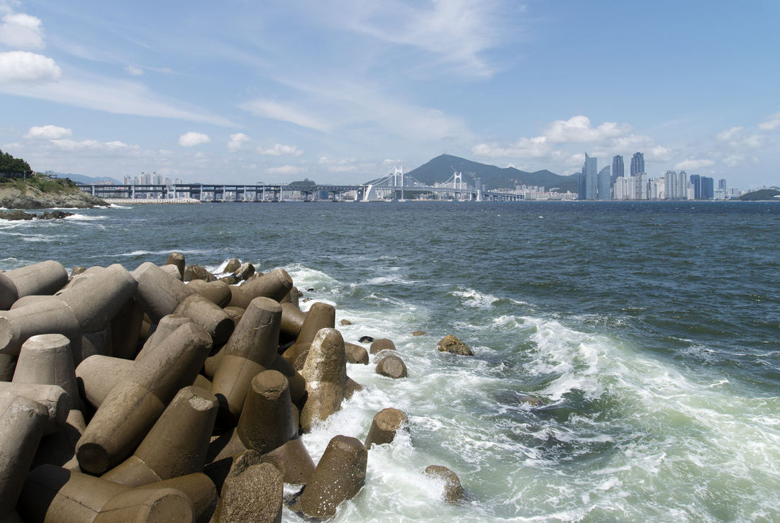 Igidae Park at Busan in Gyeongnam, South Korea Igidae Architecture Beauty In Nature Built Structure Busan City Cityscape Cloud - Sky Day Groyne Nature No People Outdoors Scenics Sea Sky Water