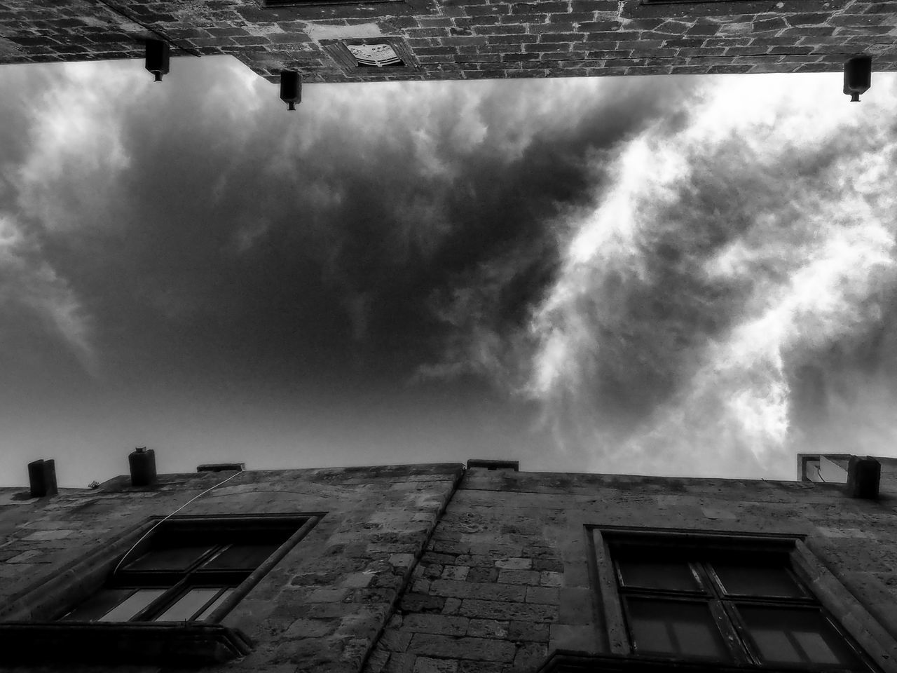 building exterior, architecture, built structure, low angle view, sky, no people, outdoors, cloud - sky, day, city