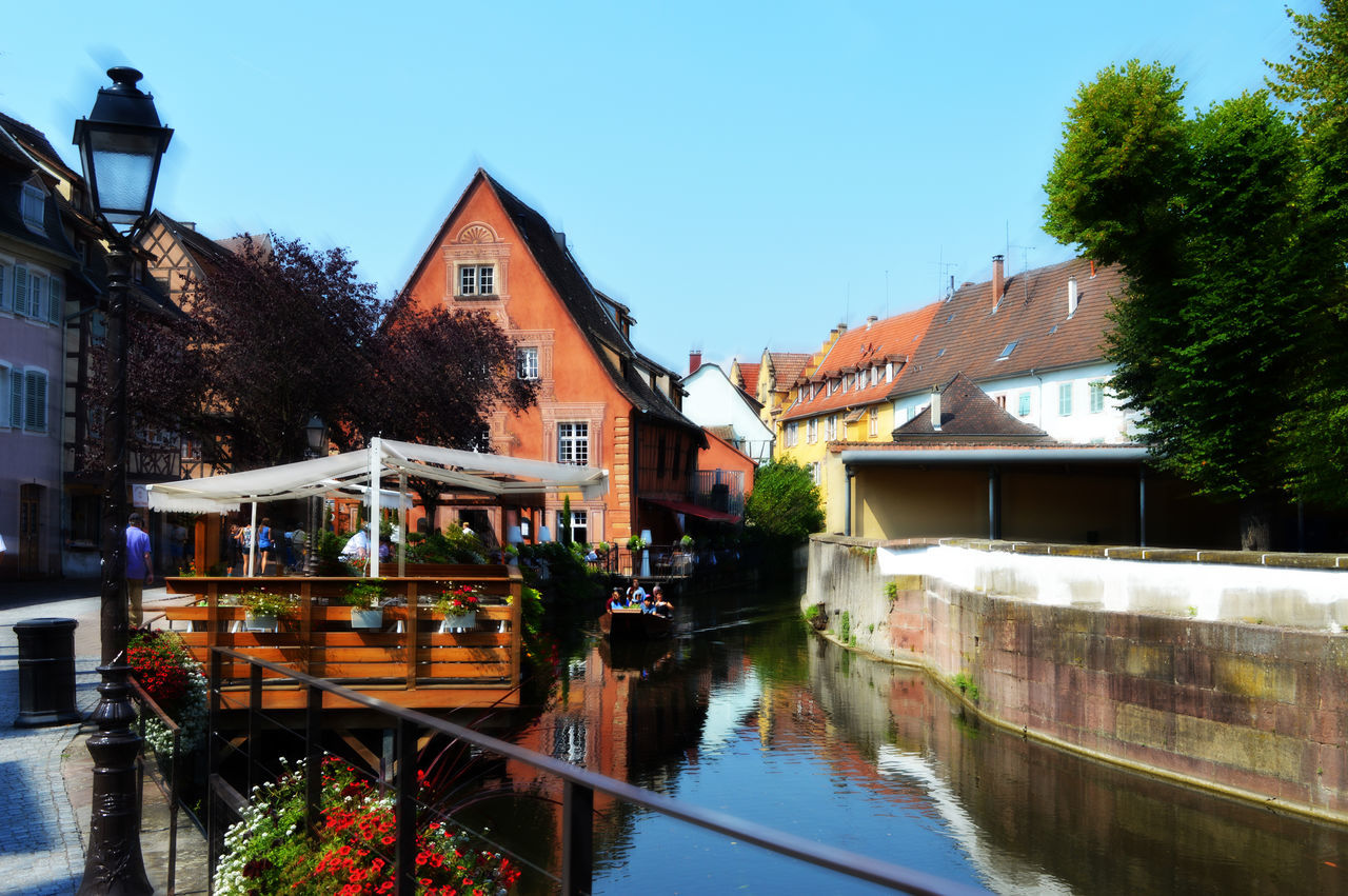 Summertime Alsace France Architecture Bridge - Man Made Structure Building Exterior Built Structure Clear Sky Colmar, Alsace, France Day Illuminated No People Outdoors Reflection River Sky Summertime Swimming Pool Tree Vacations Water