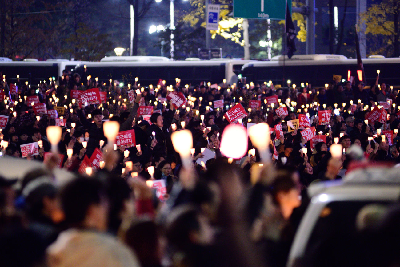 Koreans try to cure the democracy in Korea Candle Light Crowd Event For Korean Democracy Large Group Of People Men Night Outdoors People Performance Real People Spectator Togetherness