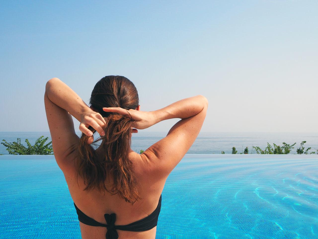 Beautiful stock photos of bikini, Adjusting, Bikini Top, Clear Sky, Day