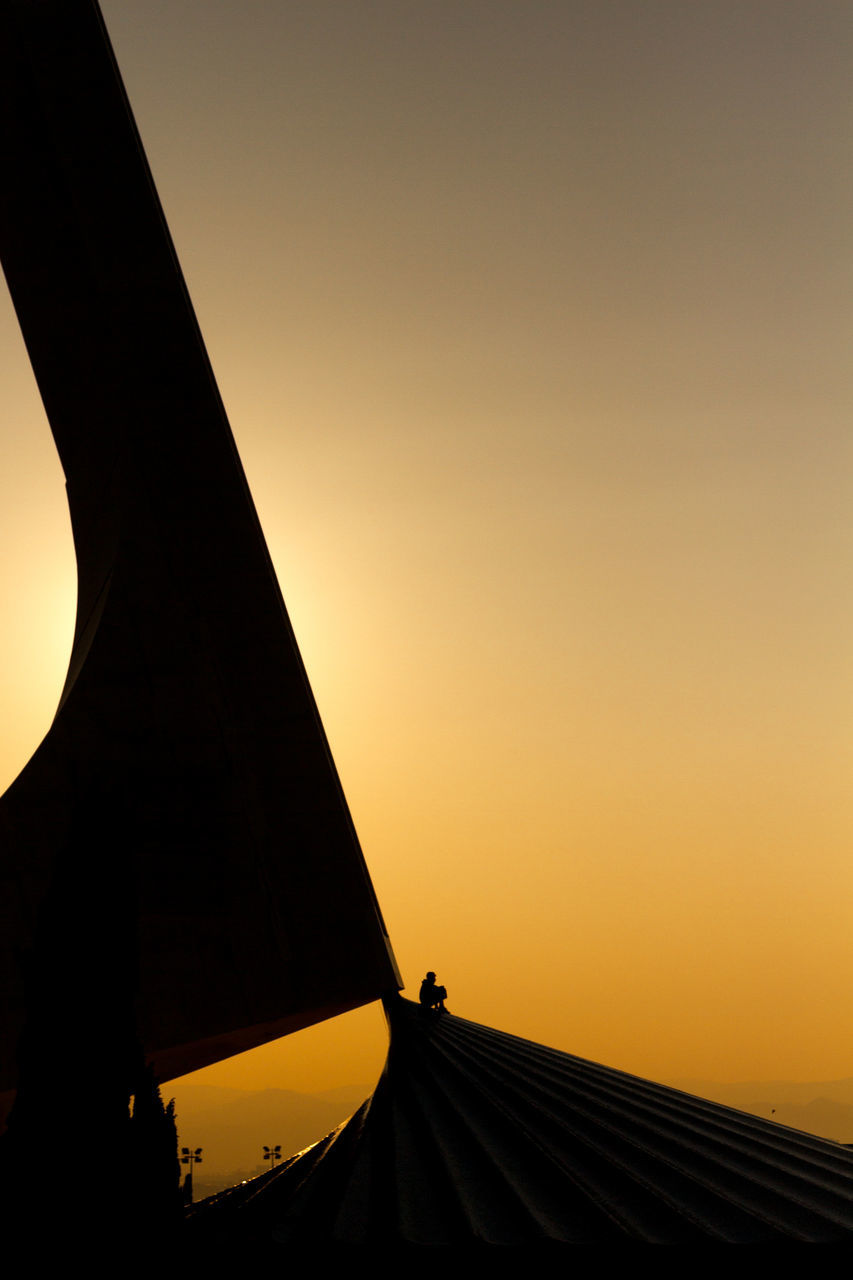 sunset, silhouette, orange color, nature, outdoors, real people, sky, clear sky, beauty in nature, architecture, day