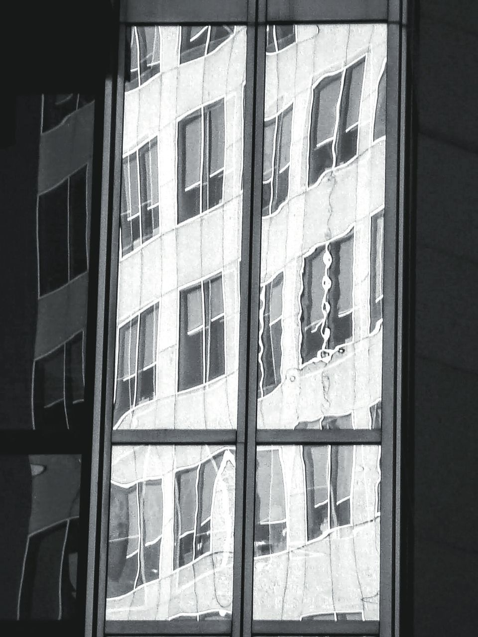 Building Reflecting On Glass Window