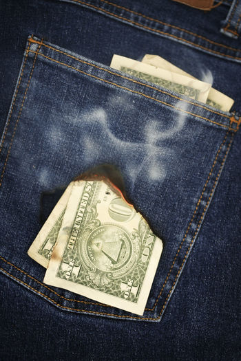 Cash burning a hole in your pocket? American Currency American Money Burning Burning A Hole In Your Pocket Cash Casual Clothing Close-up Currency Day Denim Finance Hole Jeans Money No People Paper Currency Pocket  Us Currency