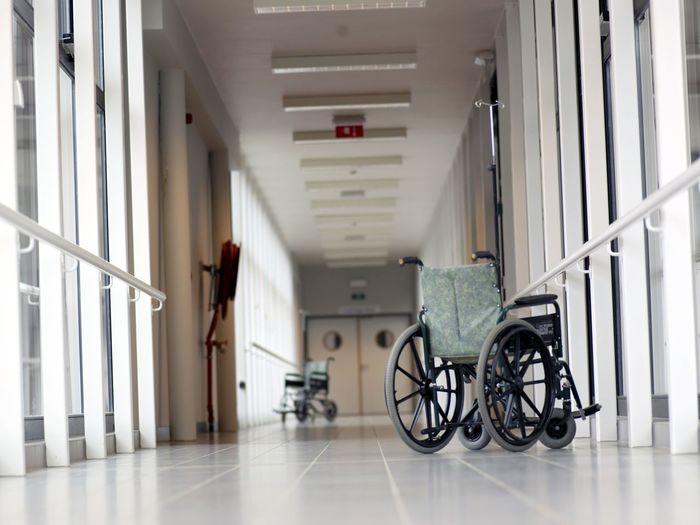 Empty wheelchairs in an hospital corridor Wheelchair Hospital Corridor Disabled