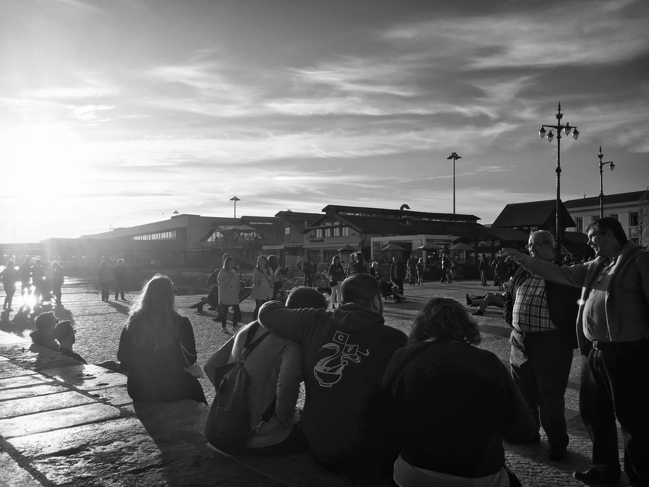 large group of people, real people, crowd, men, sky, women, outdoors, cloud - sky, lifestyles, watching, leisure activity, togetherness, sitting, day, popular music concert, city, adult, people, adults only