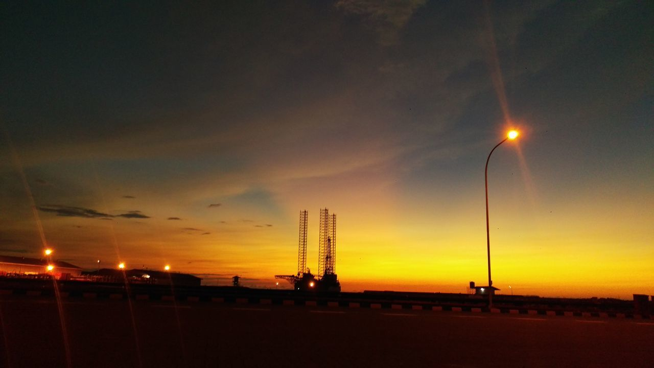 sunset, sky, silhouette, dramatic sky, street light, cloud - sky, outdoors, no people, nature, illuminated, night, beauty in nature, architecture