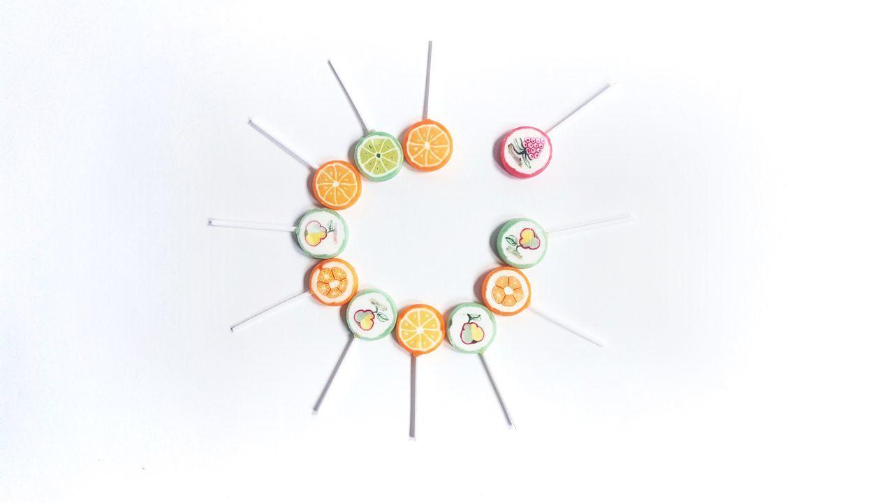 White Background Studio Shot No People Lollipop Lollipops Sweets Yummy Pastel Pastel Colors Childhood Memories Childhood Food Kiwi Pear Orange Fruits Stalk Stick Paper Clock Indoors  Multi Colored Time Geometric Shape White Album