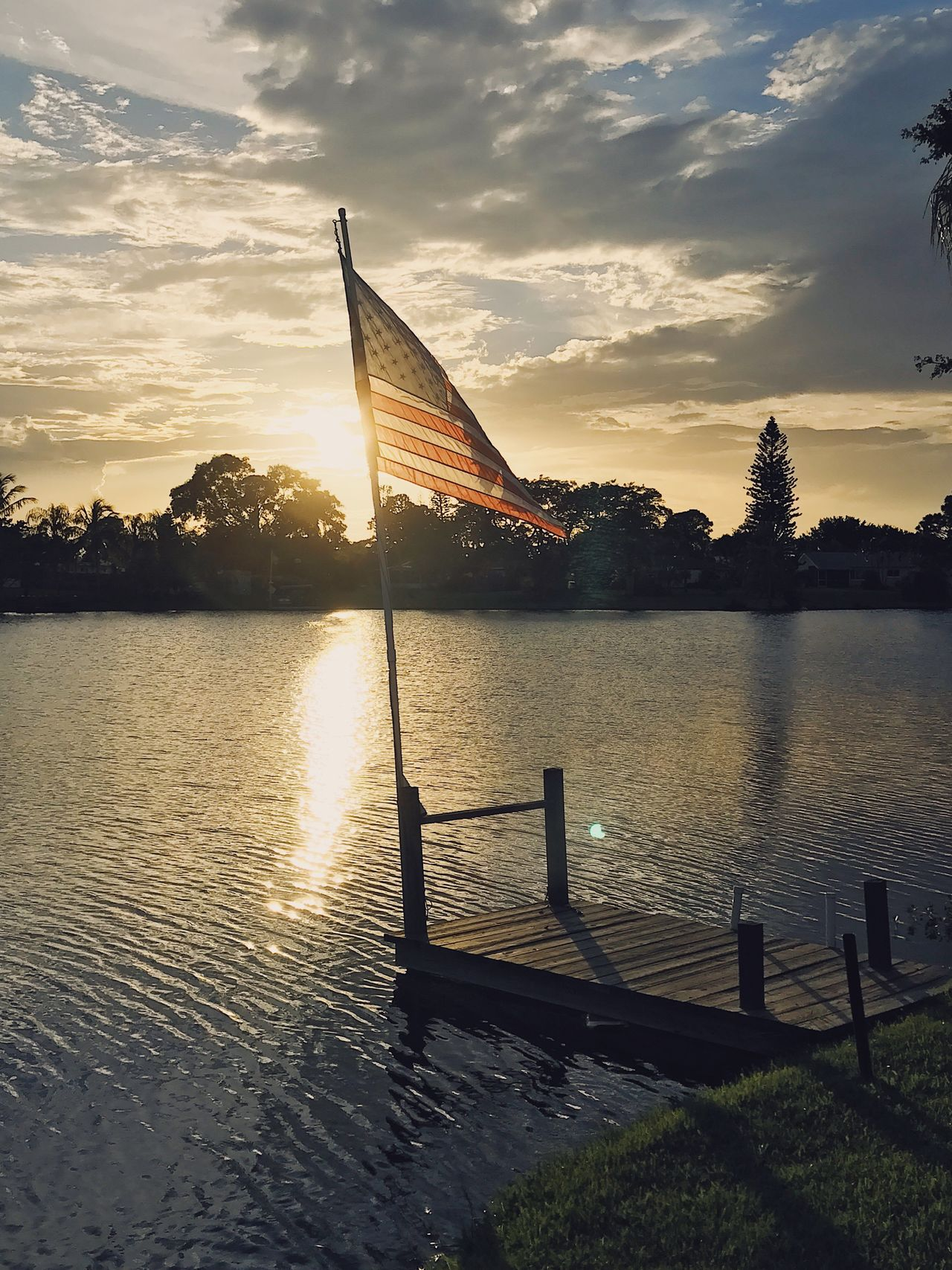 American Sunset II Sunset Water Sky Cloud - Sky River Sun Flag Scenics Reflection No People Beauty In Nature Nature Outdoors Silhouette Sunlight Travel Destinations Tree Architecture Day American Flag America USA USA FLAG Freedom Independence Day