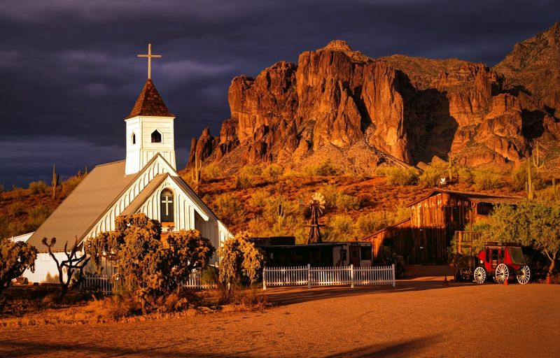Before the storm: the Elvis Memorial Chapel in the Superstition Mountains near Phoenix, Arizona Arizona Superstition Mountains Phoenix Sunset Scenic Storm Beforethestorm Apache Junction Elvis Memorial Chapel Desert Mountains Clouds