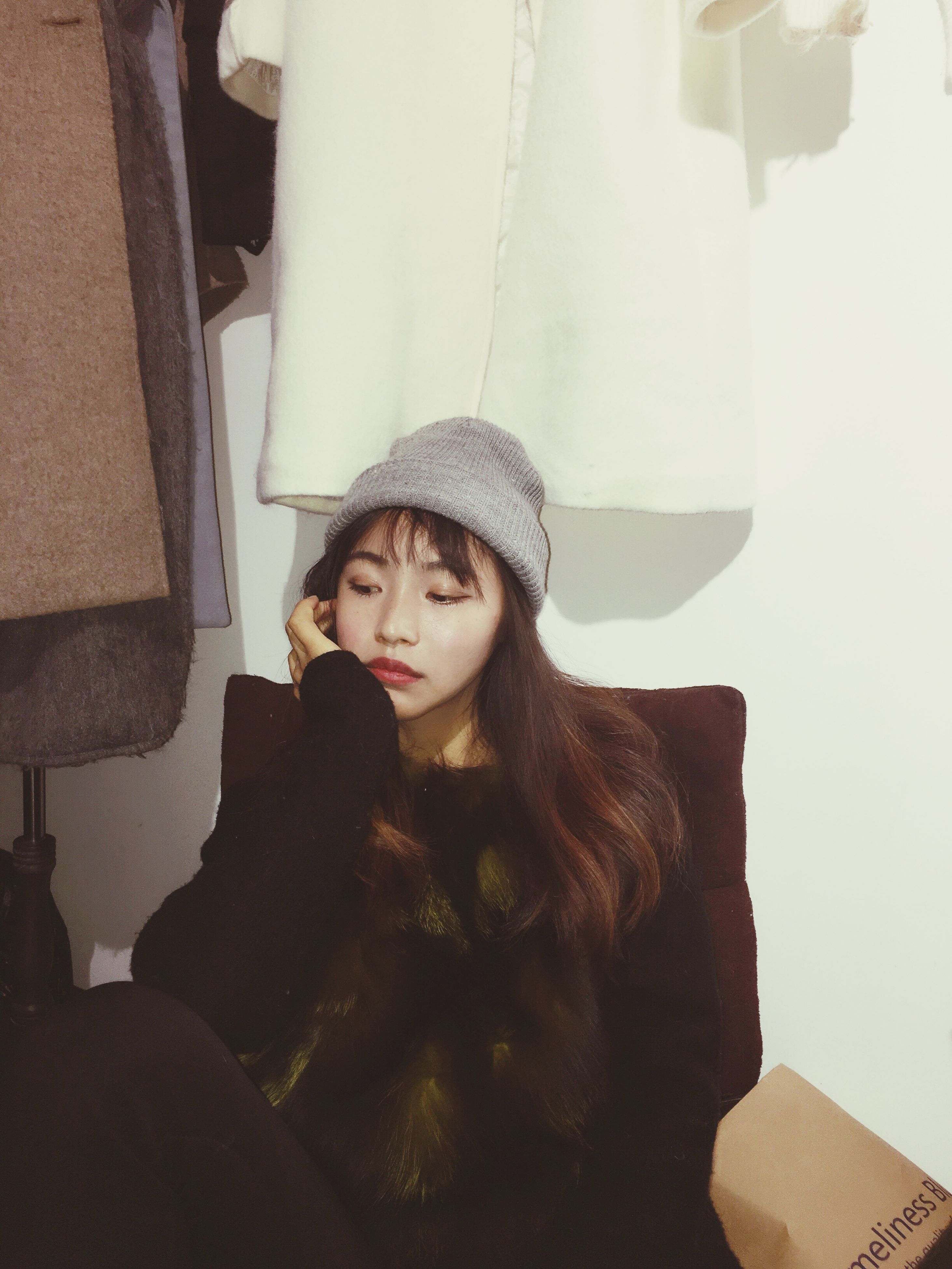 young women, lifestyles, young adult, real people, one person, waist up, beautiful woman, contemplation, leisure activity, indoors, hat, beauty, portrait, front view, home interior, warm clothing, one young woman only, only women, one woman only, day, adults only, people, adult
