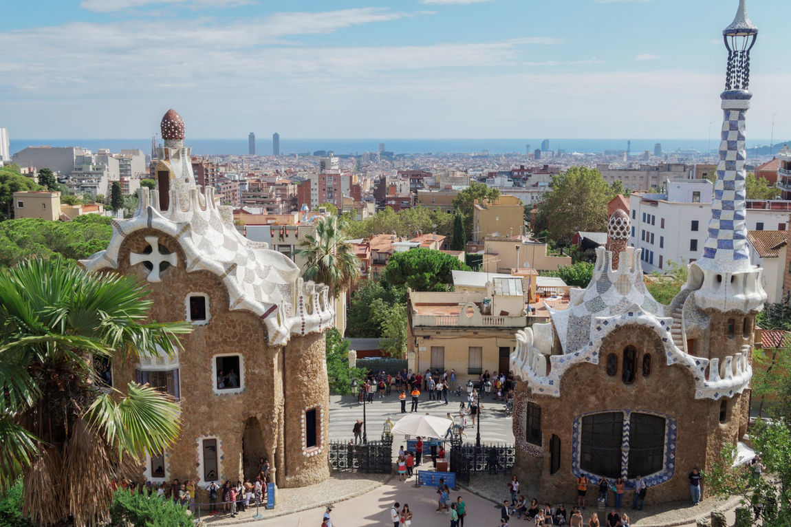 Barcelona, Spain Park Guell entrance gate and buildings. View of Barcelona City and visitors at the park entrance on the south. Antoni Gaudí Architecture Architecture Barcelona Barcelona, Spain Building Exterior Catalonia Ceramic Cityscape Gaudi Guell Guell Monumental Zone Guell Park Outdoors Park Guell Park Guell Entrance Gate Park Güell, Barcelona SPAIN Spanish Spanish Arquitecture Travel Travel Destinations Traveling Travelphotography Urban Skyline