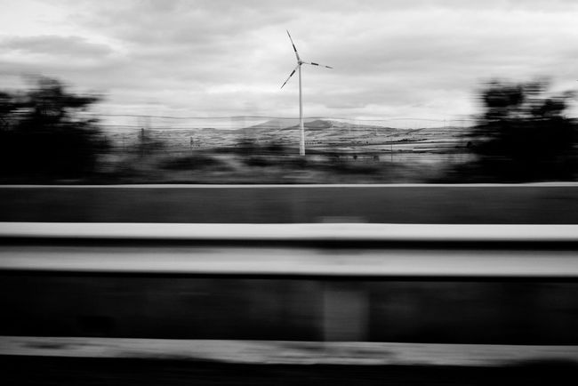 Capturing Motion so fast, by Claudia Ioan Alternative Energy Wind Turbine Wind Power Windmill Renewable Energy Environmental Conservation No People Outdoors Sky Monochrome Photography Black And White Blur Blurred Motion EyeEm Gallery Travel The Roll Day