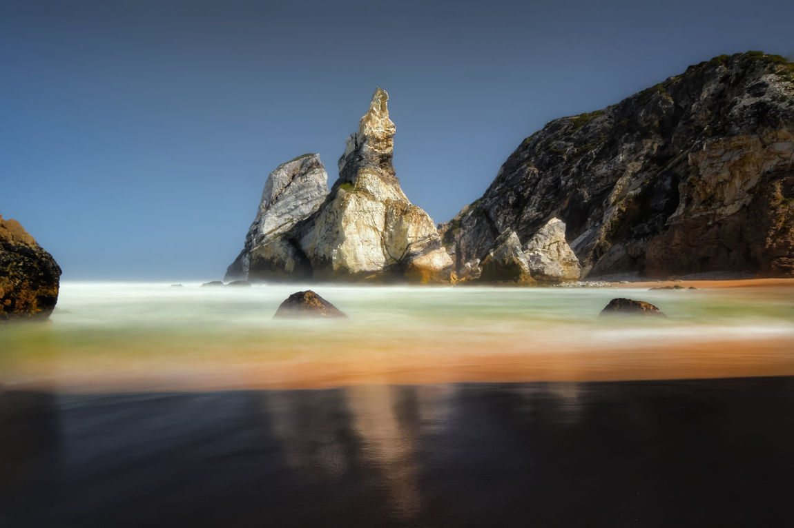 Reflection Travel Water Travel Destinations Landscape No People Sky Outdoors Night Stream - Flowing Water Sunset Sintra (Portugal) Popular Photos Eye4photography  Popular Praia Da Ursa Rock Formation Ursa Beach Beauty In Nature Long Exposure Beachphotography Beach Nature Sunset_collection Paradise Beach