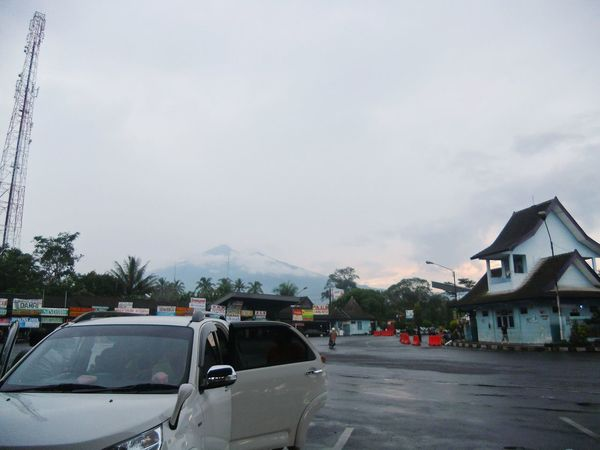 I'm singing in the rain, just singing in the rain. What a glorious feeling. Rain Mountain View Bus Station Salatiga Central Java INDONESIA