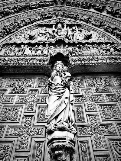 Simmetry Simmetrical Cathedral Gothic Statue Sculpture Architecture Gate Church Door Facade Detail Black And White Photography Blackandwhite Human Body Part Day Pattern Full Frame Low Section Outdoors People Close-up
