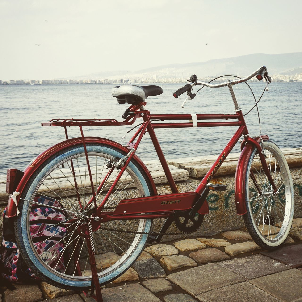 bicycle, transportation, mode of transport, water, sea, outdoors, land vehicle, day, stationary, nature, no people, nautical vessel, sky