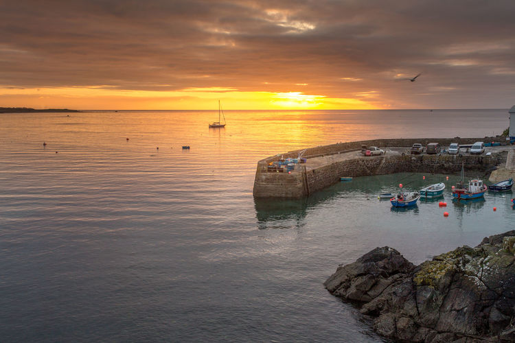 Sunrise over the harbour at Coverack on the Cornish coast, Cornwall Beach Beauty In Nature Cloud - Sky Cornish Coast Coverack Harbour Day Horizon Over Water Nature Nautical Vessel No People Outdoors Reflection Rock - Object Scenics Sea Sky Sun Sunrise Tranquility Travel Destinations Water