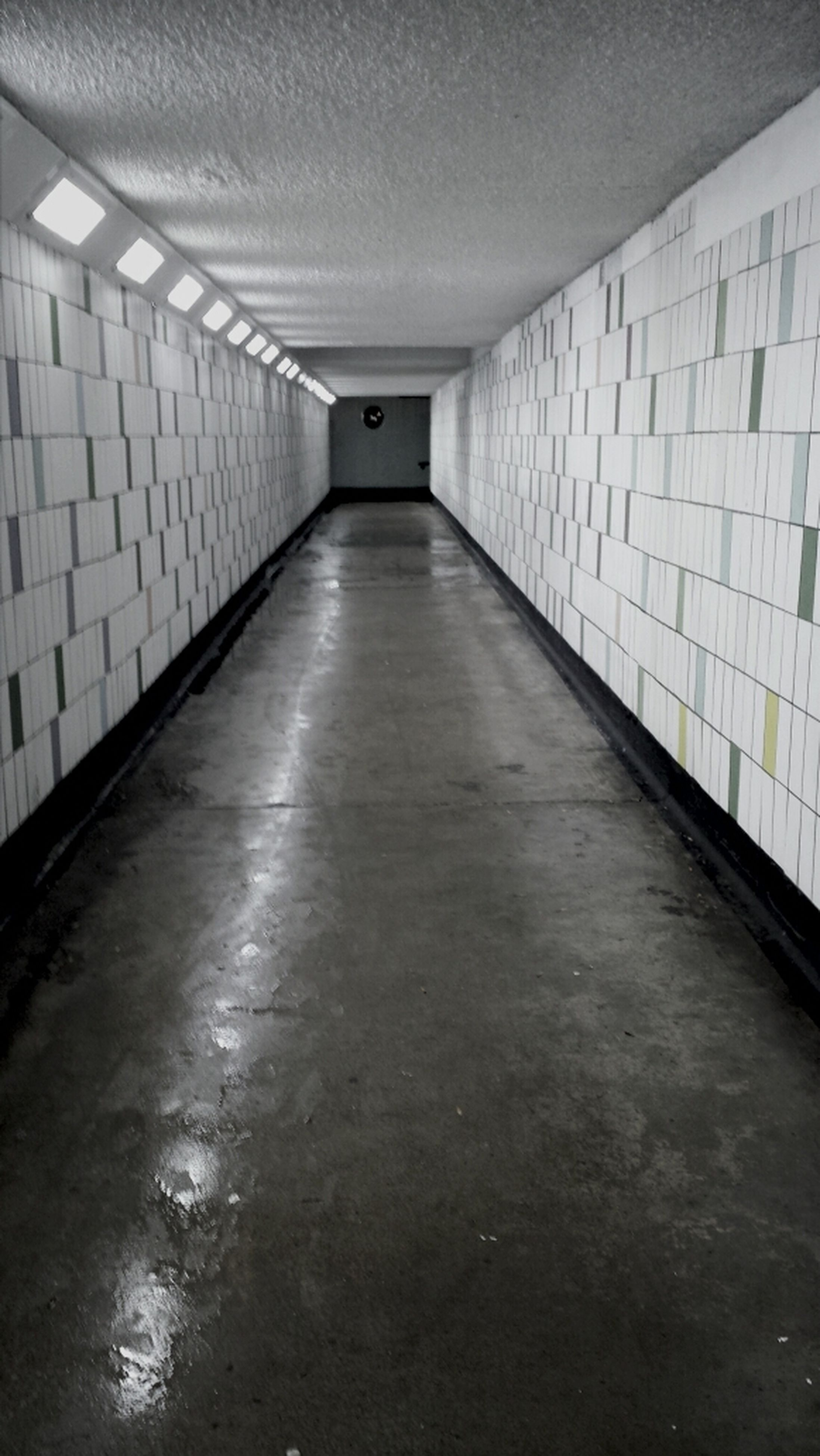 indoors, the way forward, architecture, corridor, built structure, illuminated, diminishing perspective, empty, ceiling, wall - building feature, absence, flooring, lighting equipment, tunnel, narrow, building, vanishing point, wall, tiled floor, interior
