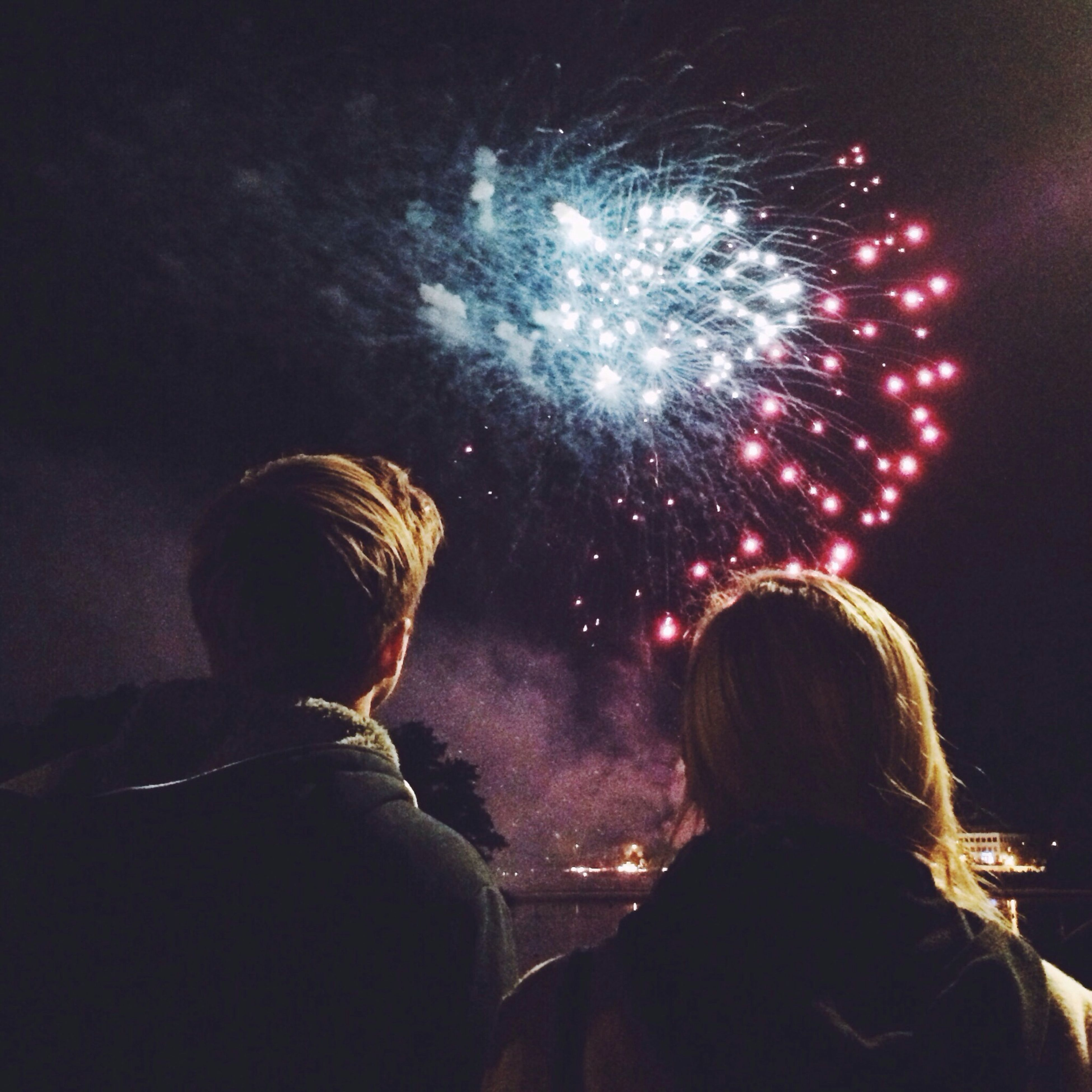 night, illuminated, lifestyles, leisure activity, arts culture and entertainment, celebration, rear view, men, firework display, person, headshot, sparks, event, motion, long exposure, exploding, glowing, firework - man made object