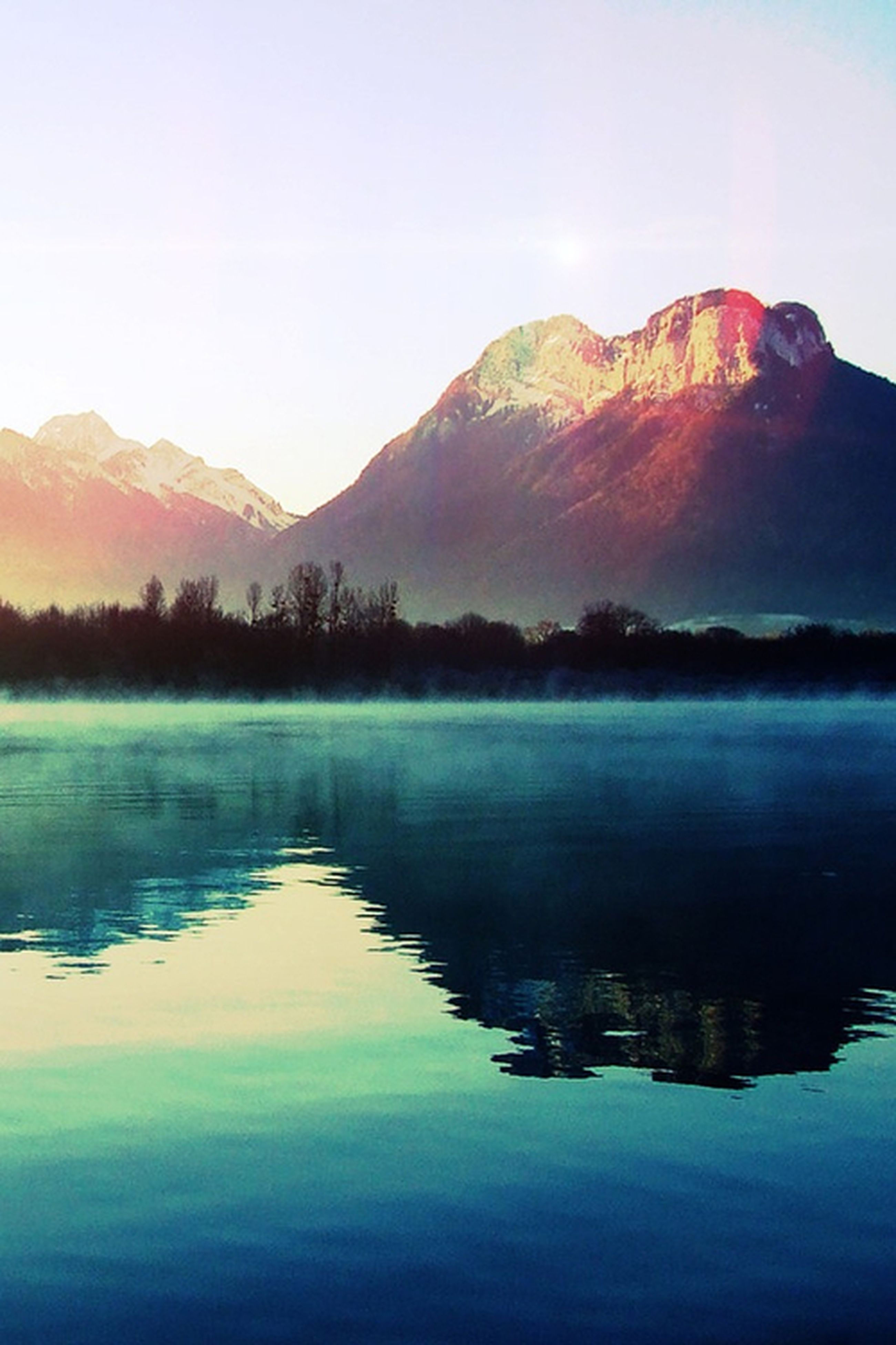 water, mountain, reflection, lake, tranquil scene, scenics, tranquility, waterfront, beauty in nature, clear sky, mountain range, nature, idyllic, sky, non-urban scene, calm, outdoors, majestic, no people, standing water