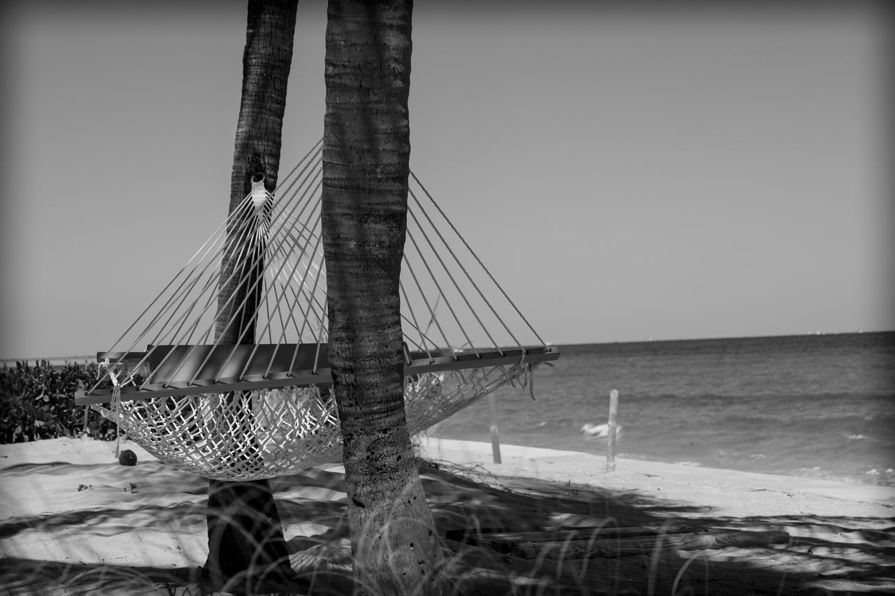 Life is a Beach Beach Beach Life Beach Photography Blackandwhite Photography Clear Sky Day Fujifilm_xseries Hammock Horizon Over Water Lazy Day Leisure Activity Life Is A Beach Lifestyle Light And Shadow Nature Nautical Vessel No People Outdoors Palm Trees Photographyisthemuse Scenics Sea Sky Water