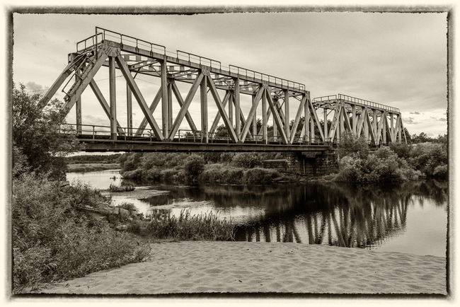 Railway bridge over the river Volchina Architecture Blackandwhite Bridge - Man Made Structure Day Maksatiha Maksatikha No People Outdoors Railroad Railroad Bridge Railway Bridge River Russia Sky Transportation Volchina Water