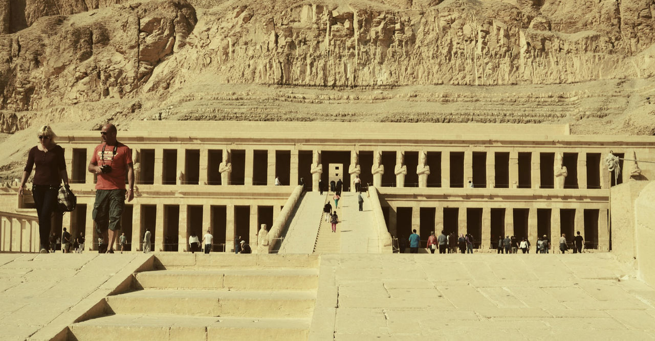 Tourists walking outside the mortuary Temple of Queen Hatshepsut (3500 years old temple) - Luxor, Egypt Ancient Civilization Architecture Building Built Structure Civilization Column Culture Egypt Famous Place Hatshepsut Historic History Luxor Old Pharaohs Tadaa Community Temple Tourism Tourists