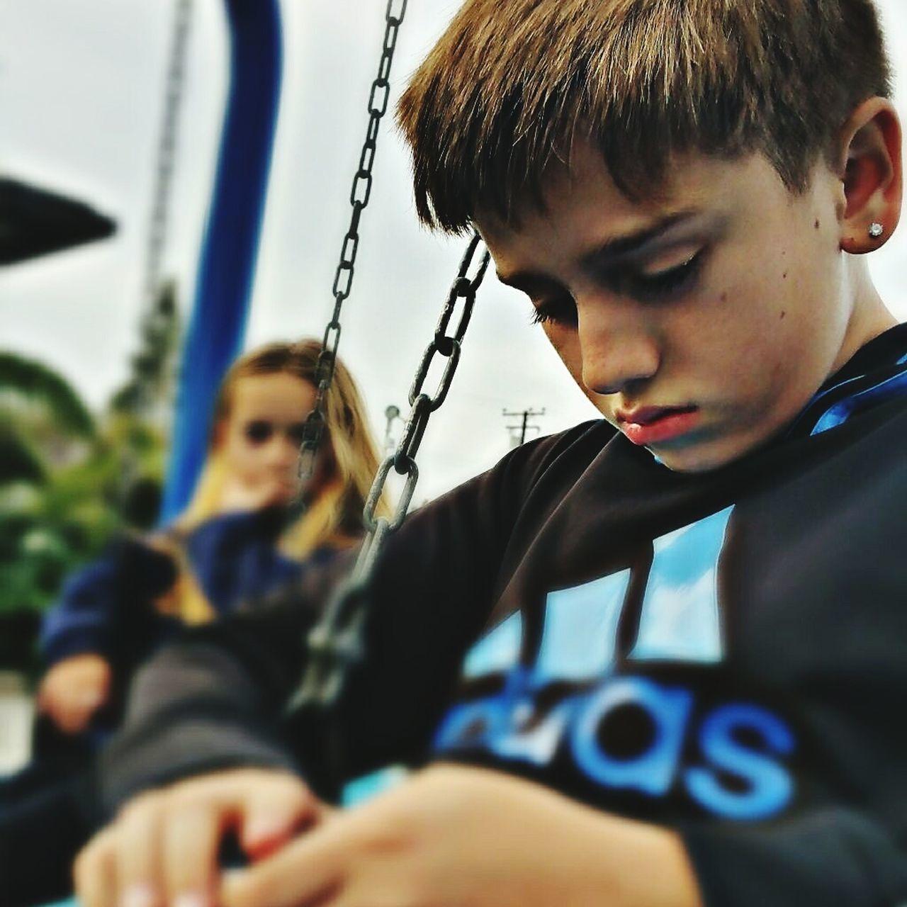Child Childhood Son FatherSonMoments True Love Bitter-Sweet The Park Swinging Technology Electronics  Games Separation Sadness😢 Godrules Jesus Christ My Savior