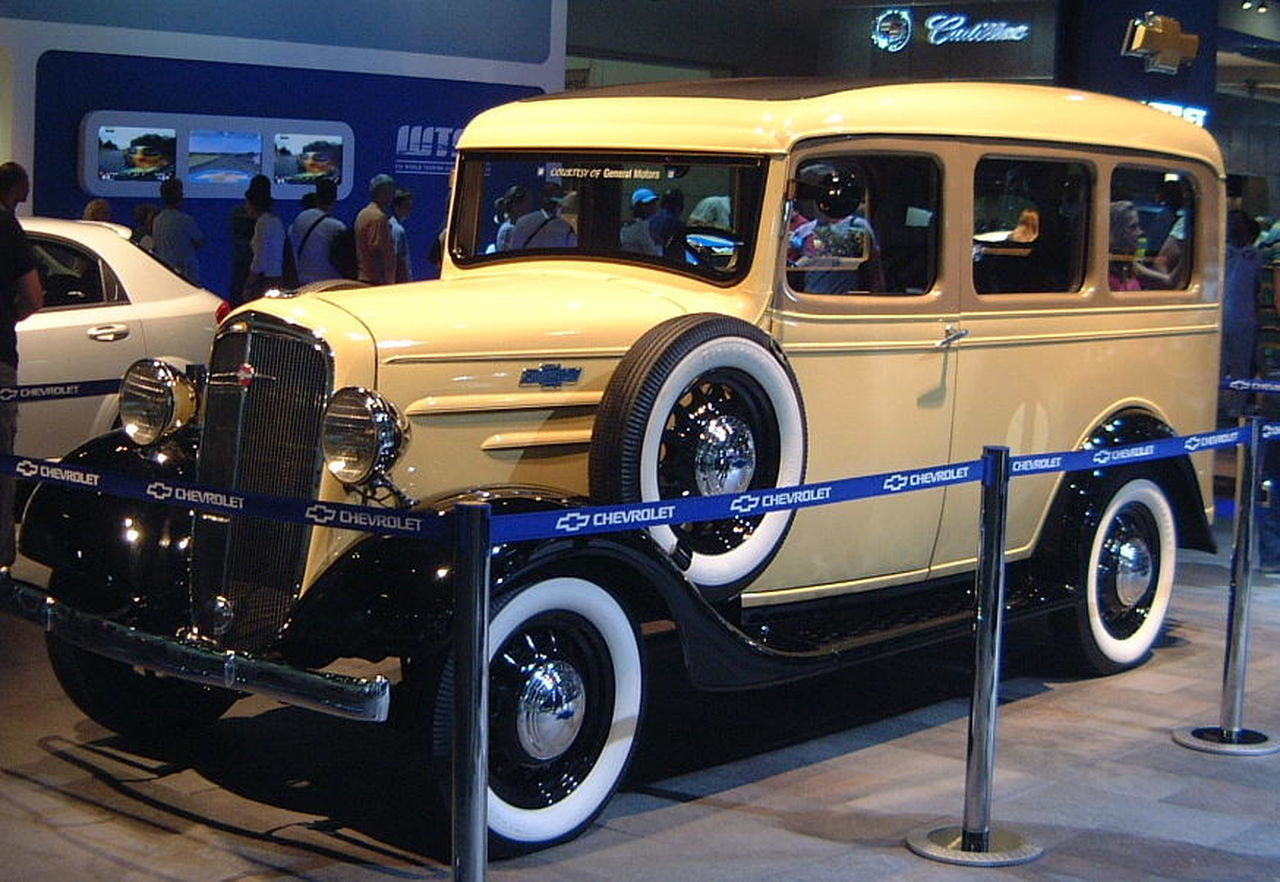Vintage Chevrolet by General Motors Bus Chevrolet Composition Exhivition Full Frame GB General Motors  Illuminated Indoor Photography Land Vehicle London Mode Of Transport Motor Show No People Old Parked Stationary Transportation Uk Vintage Car White Wall Tires Yellow Colour