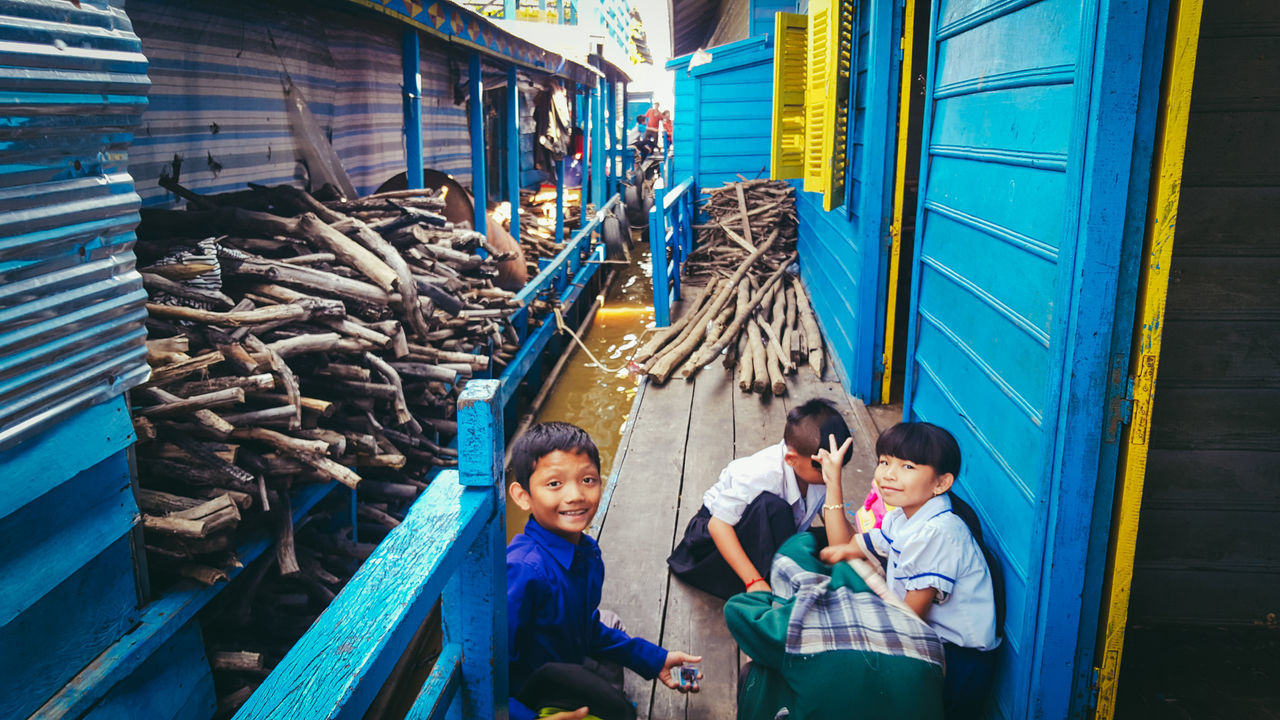 """""""We are the floating village orphans. We get to take a break, have fun, and play. We mean, think of the brighter side."""" People Day EyeEmNewHere EyeEm Eyeem Philippines Cambodia Tonlesaplake Kid Kids School Play Orphanage School Orphanage Orphan Lake AdobeLightroom Adobe"""