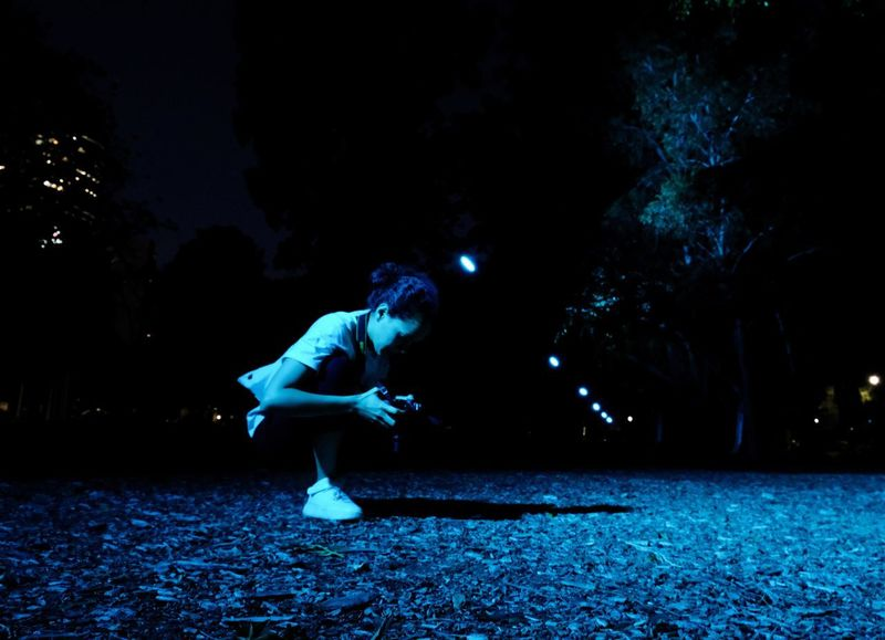 Energetic Full Length Illuminated Leisure Activity Lifestyles Motion Nature Night One Person Outdoors People Real People Sportsman Tree Young Adult