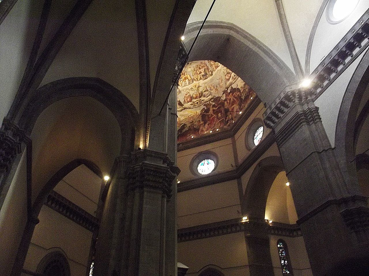 architecture, indoors, low angle view, illuminated, arch, ceiling, built structure, no people, place of worship, day