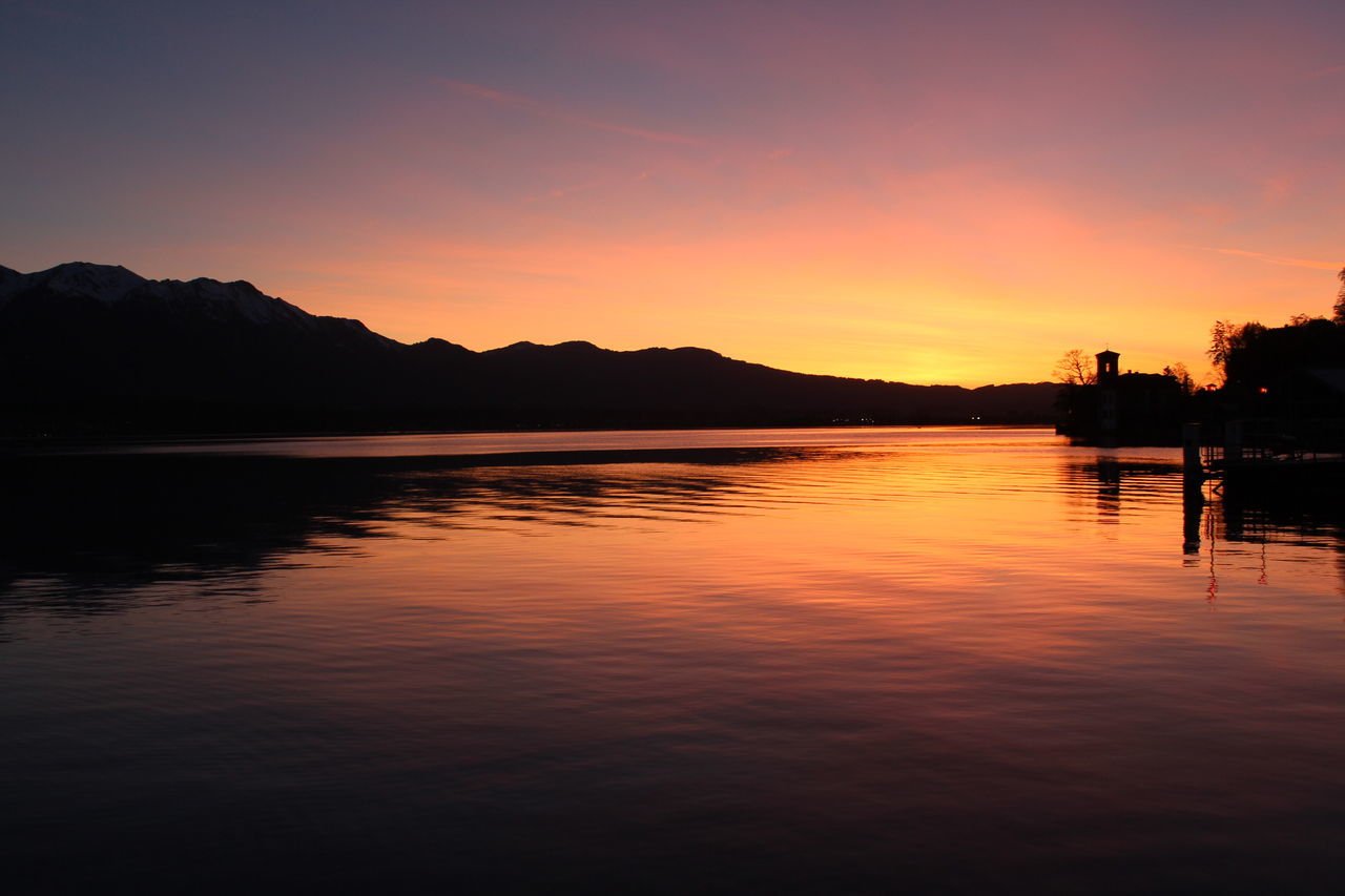 sunset, water, reflection, silhouette, beauty in nature, tranquility, scenics, nature, tranquil scene, waterfront, lake, sky, no people, outdoors, mountain