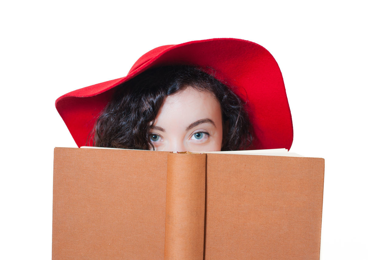 Woman With Book On Face Against White Background