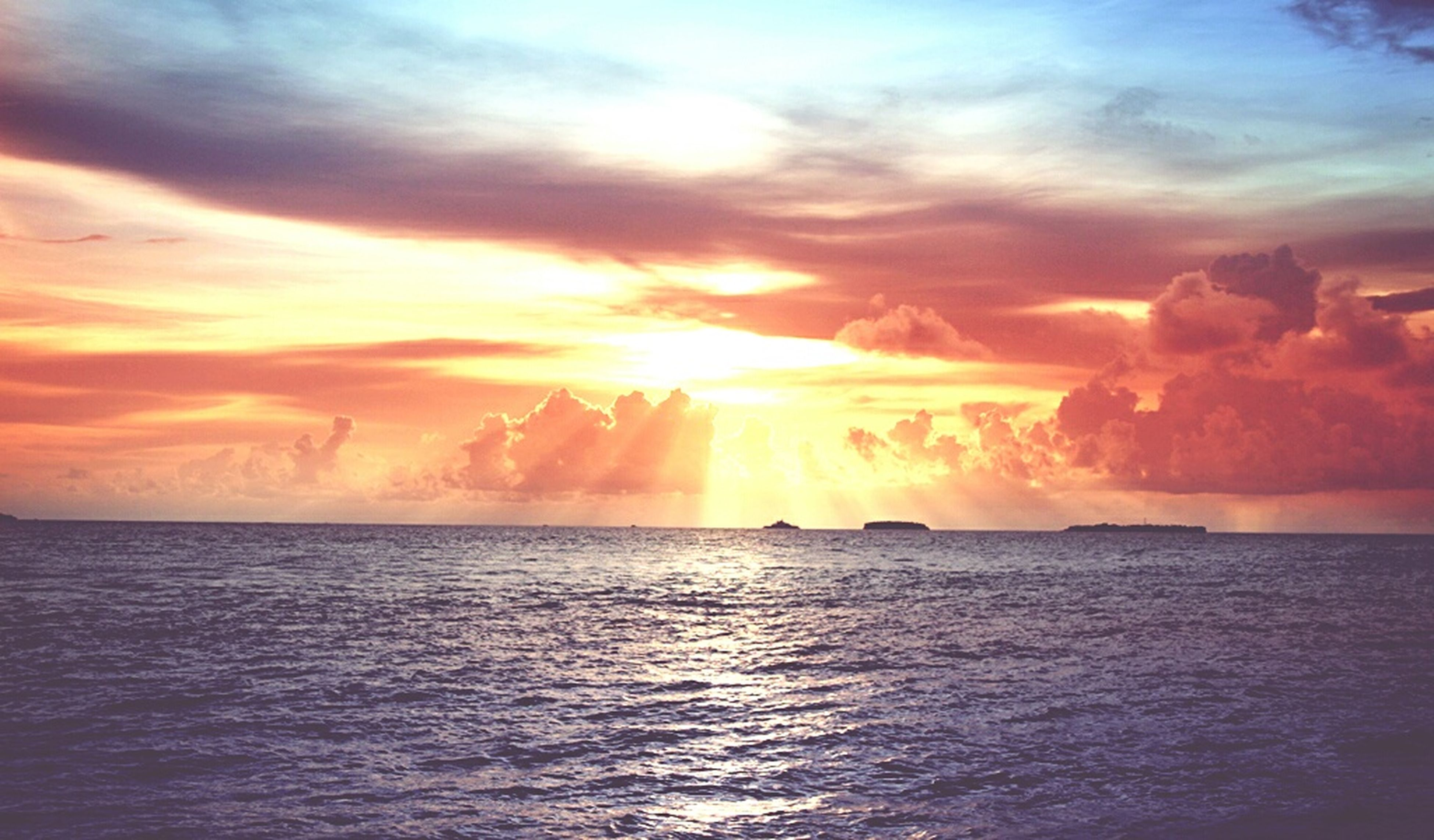 sunset, sea, water, scenics, sky, tranquil scene, beauty in nature, horizon over water, waterfront, tranquility, cloud - sky, orange color, idyllic, sun, nature, cloud, cloudy, dramatic sky, rippled, seascape