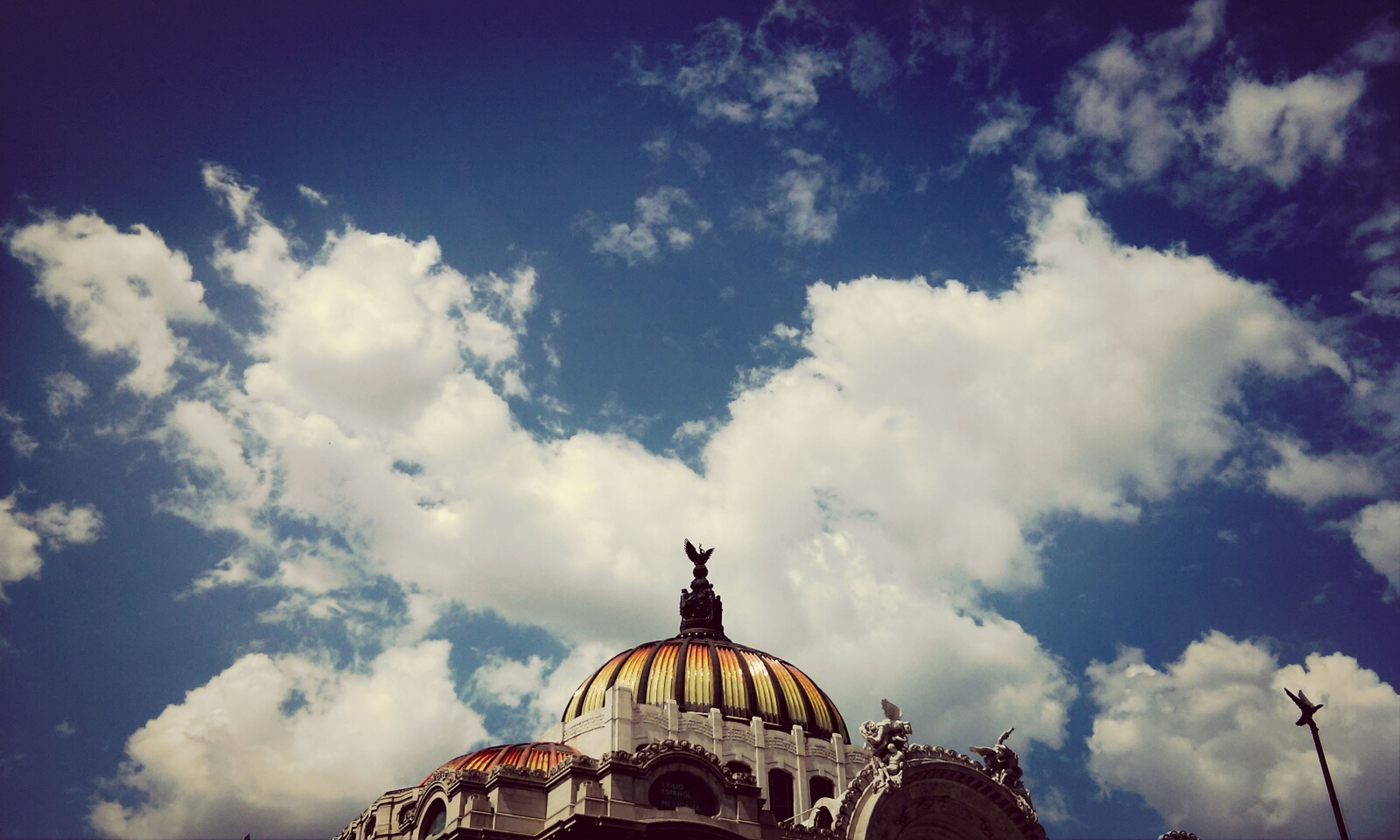architecture, low angle view, built structure, dome, sky, building exterior, place of worship, cloud - sky, religion, spirituality, famous place, travel destinations, high section, cloudy, cathedral, travel, international landmark, tourism, church