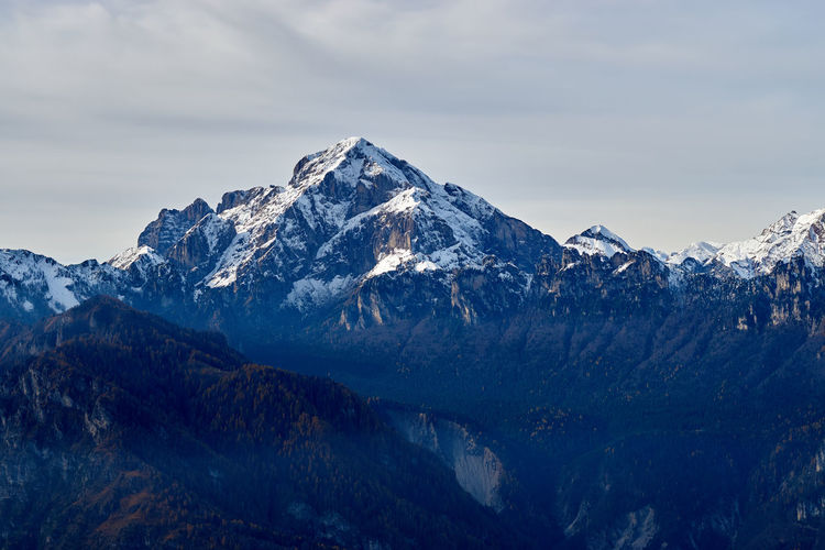 The majestic pyramidal shape of Mt. Pelf towering over the Forest of Cajada, after an early autumn snowstorm. Belluno Dolomites, Italy Dolomiti Bellunesi Longarone Beauty In Nature Landscape Mountain Mountaineering Landscape Nature Peak Snow Snowcapped Mountain
