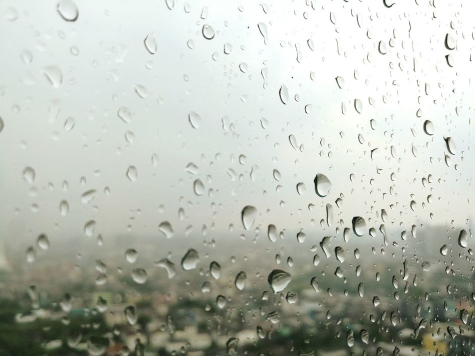 Drop Transparent Window Rain Day Wet Sky No People Nature Full Frame Rainy Season Water RainDrop Backgrounds Close-up Outdoors Drops Of Rain Drops Of Water Rain On Window EyeEmNewHere Daylight True Blue Sad Day Glass_collection Emotions Long Goodbye