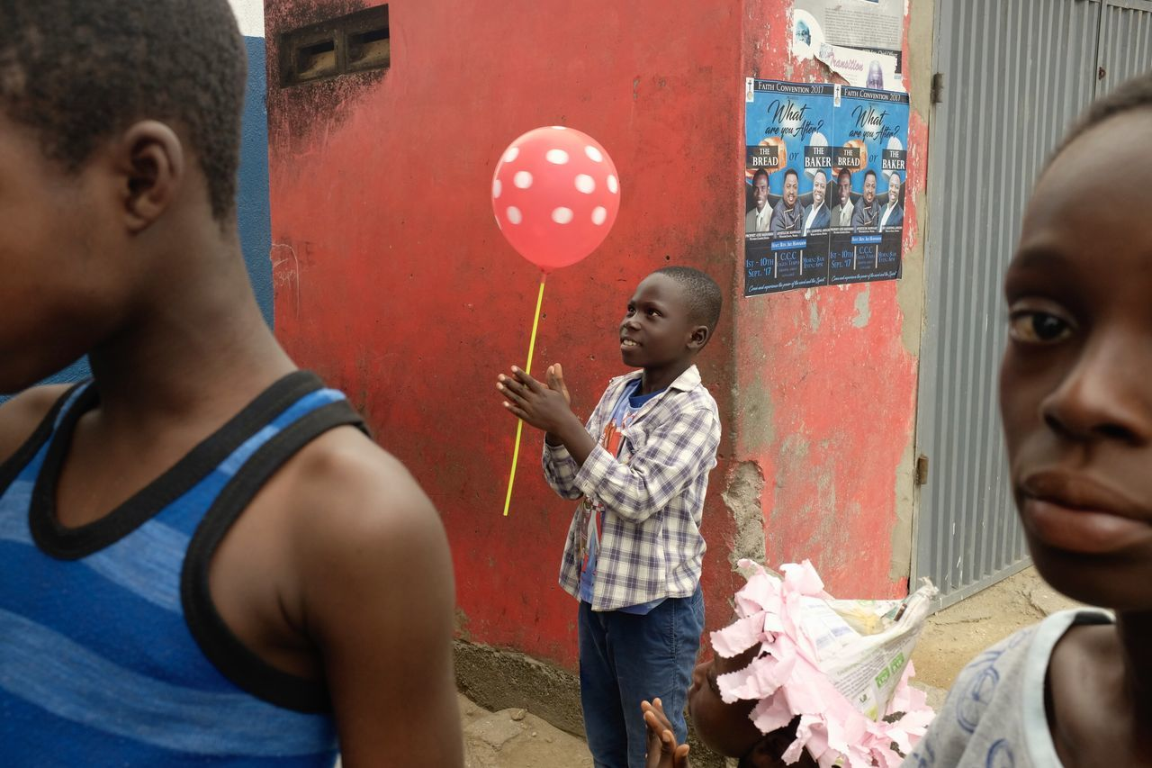 Red, Cape Coast Ghana West Africa Balloon Boys Childhood Colour Colour Of Life Face Friendship Girl Girls Playing Real People Standing Street Street Photography Street Scene Togetherness