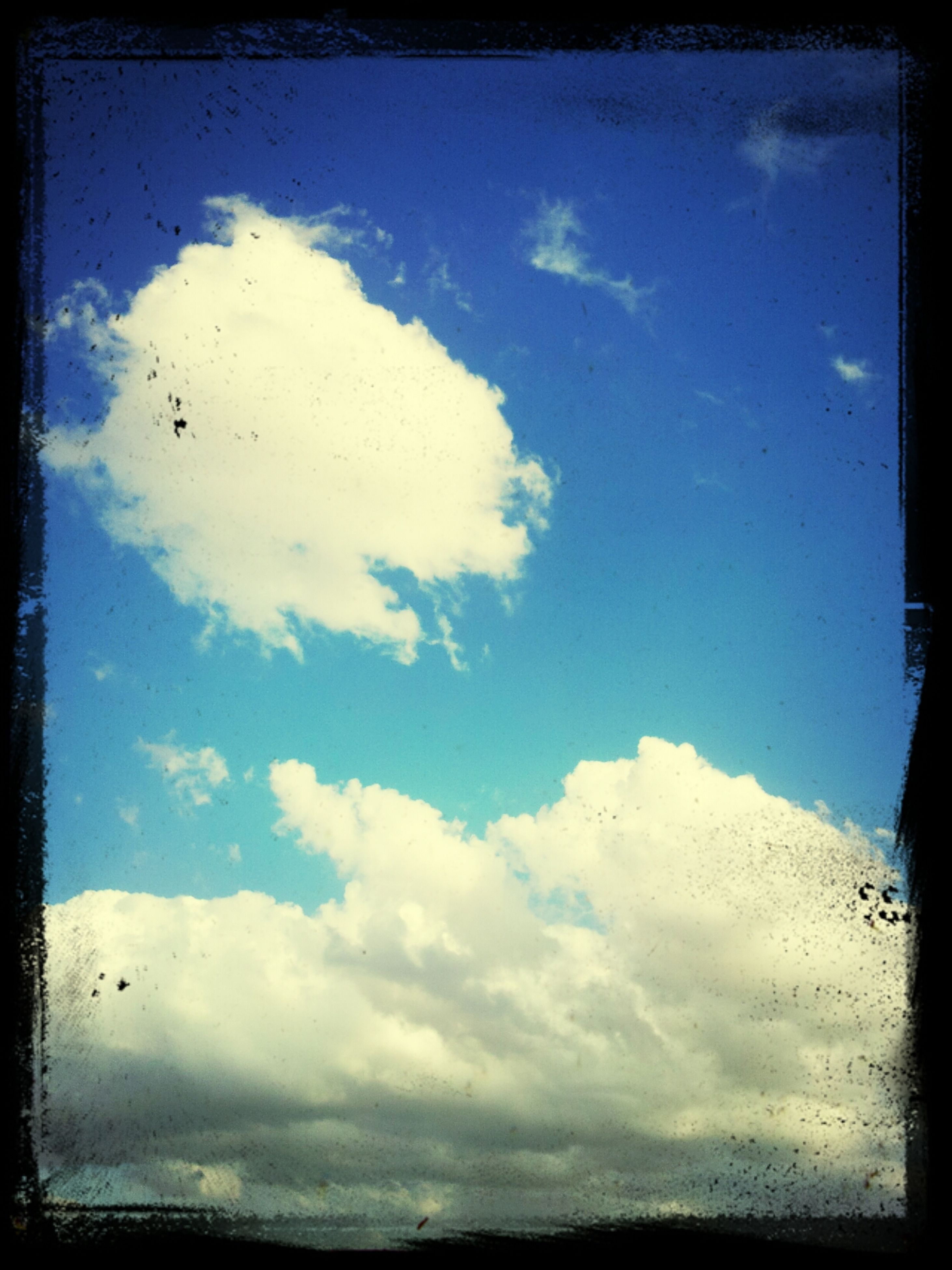 transfer print, sky, auto post production filter, blue, cloud - sky, low angle view, cloud, tranquility, beauty in nature, tranquil scene, scenics, nature, cloudy, day, outdoors, no people, flying, silhouette, idyllic, cloudscape