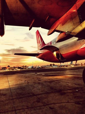 Airplane Air Vehicle Airport Transportation Airport Runway Runway Travel Aircraft Wing Mode Of Transport Sky Commercial Airplane Flying No People Airplane Wing Outdoors Day Aerospace Industry EyeEmNewHere Be. Ready. EyeEmNewHere